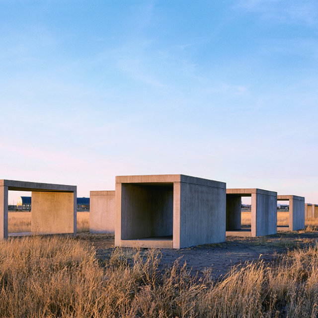 Cement blocks that Judd built across the plains in Marfa, Texas. Each block measures 8 feet in height and width and 16 feet long.