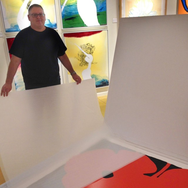 Gary Santoro with Donald Sultan's Big Poppies (Red), 2014 Color silkscreen with flocking and tar-like texture on white 4-ply museum board 59 x 59 in Edition of 30